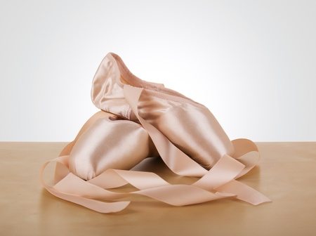 pointe: new pair of ballet shoes with ribbons