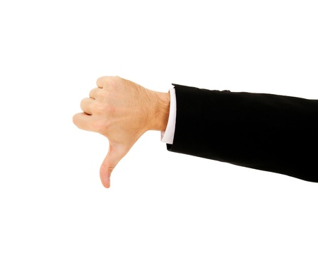 disagree: businessmans hand shows thumb down on a white background