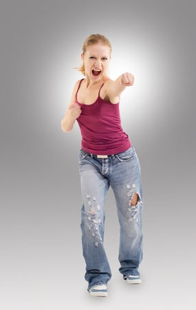 Aggressive girl makes a punch Stock Photo - 10964032