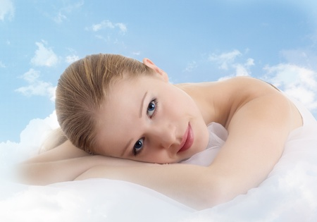cushion: young beautiful girl is resting in the clouds