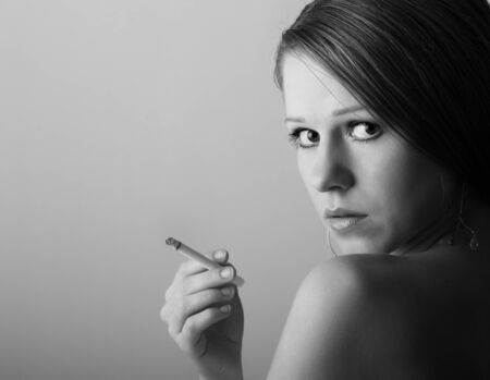 portrait of a beautiful girl with a cigarette photo