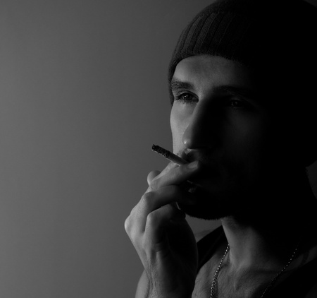 lonely young man with a cigarette in the dark Stock Photo - 11566653