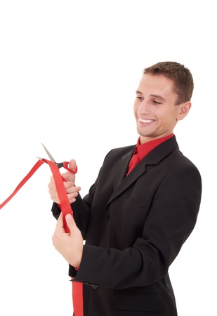 business man cutting a red ribbon, scissors Stock Photo - 11566650