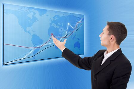 businessman and a modern map with charts  photo