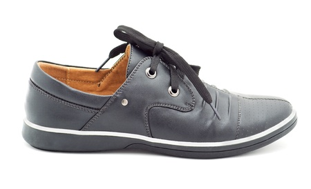a new black mans shoes on a white background Stock Photo