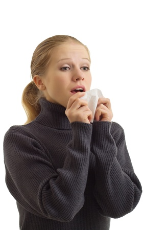 A sneezing woman isolated over white  Stock Photo