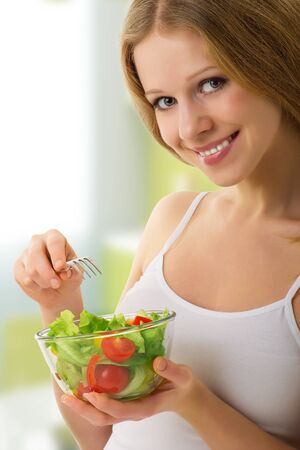 beautiful girl with vegetable vegetarian salad photo