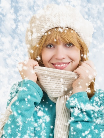 Winter portrait of a young cheerful happy women photo