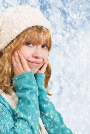 beautiful blonde girl in winter with snowflakes photo