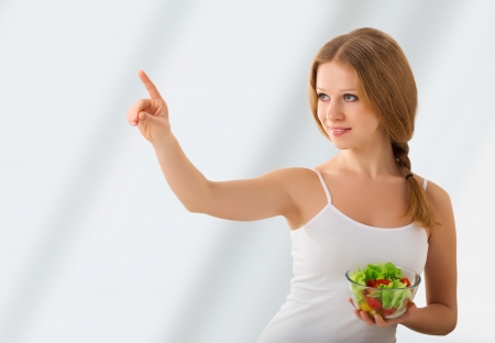 beautiful girl with a salad choose healthy food photo