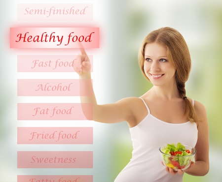 healthy life: girl  with vegetable salad choose healthy food Stock Photo