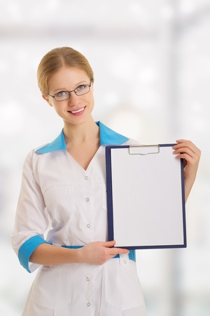 Smiling  female medical doctor with clipboard photo