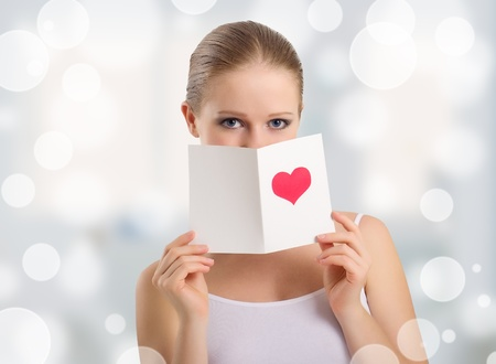 beautiful woman holding a valentine postcard photo