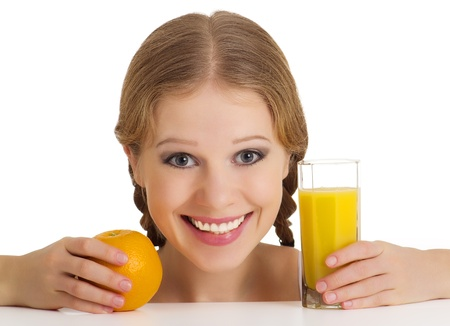 beautiful happy cheerful girl with orange juice photo