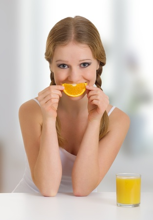 beautiful girl full of life with orange juice photo