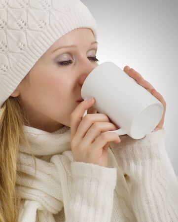 beautiful girl in winter clothes drinking  drink photo