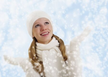 beautiful happy girl with snowflakes in  winter  photo