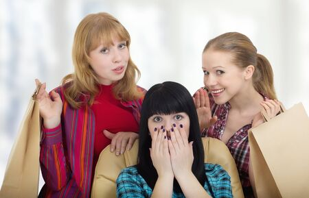 Three girls girlfriends talking about shopping photo