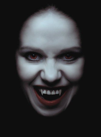 portrait of a woman vampire with fangs  photo