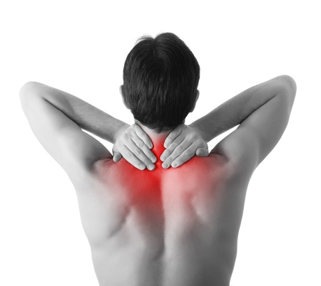 aching muscles: Rear view of young man holding  neck in pain