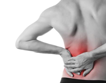 epaule douleur: jeune homme tenant son dos dans la douleur, isolé Banque d'images