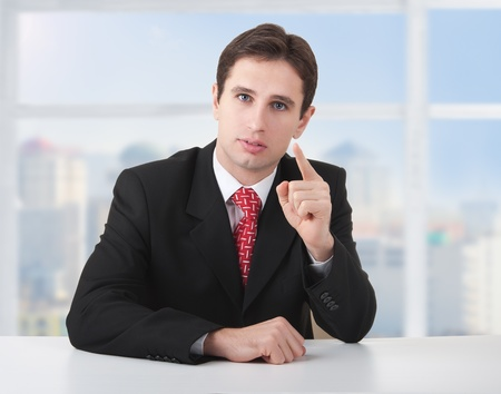 seriously: successful business man seriously  at  desk