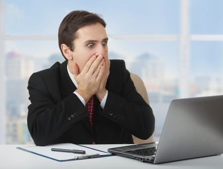 worried businessman: surprised  frightened businessman, laptop,
