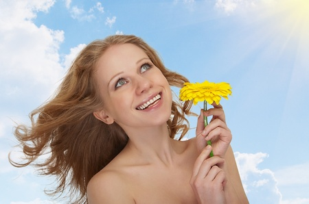 beautiful  woman with flowing hair,  gerbera  photo