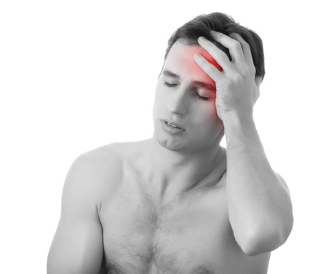 muscle tension: man with headache  isolated over white
