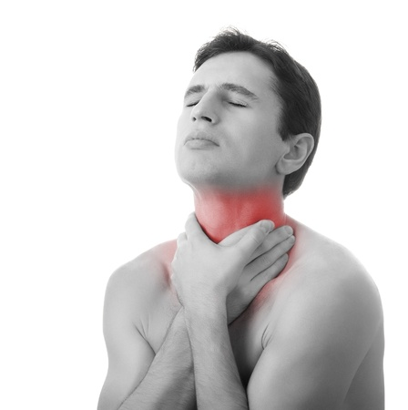 young man holding his throat in pain, isolated photo