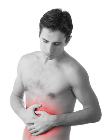 dolor abdominal: hombre joven sosteniendo su estómago enfermo de dolor, Foto de archivo