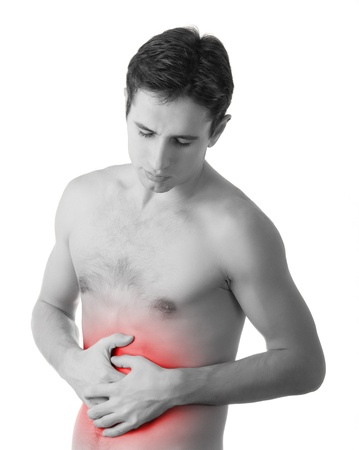 stomach: young man holding his sick stomach in pain,