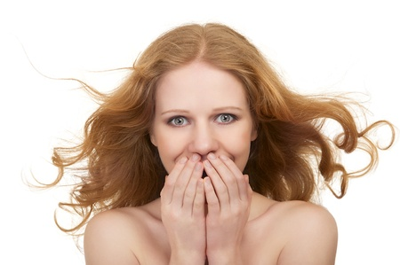 flowing hair: Beautiful surprised young woman  isolated  Stock Photo