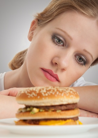beautiful girl sits on a diet,  hamburger photo