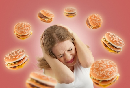 fast eat: diet concept. frightened girl in the stress