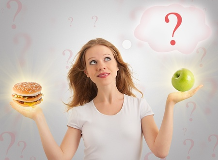 high calorie foods: girl makes choice:  healthy and unhealthy food