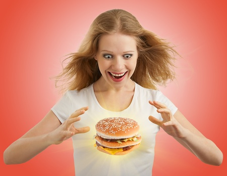 diet concept: diet concept. Happy girl and a hamburger  Stock Photo
