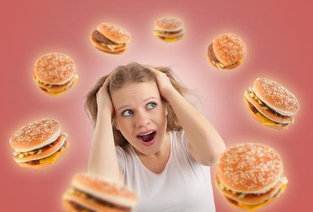 diet concept: diet concept. young woman, burgers  Stock Photo