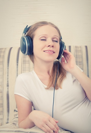 beautiful girl listening to music on headphones photo