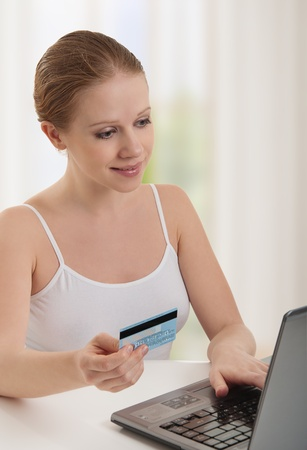 woman  with a laptop makes a payment online photo