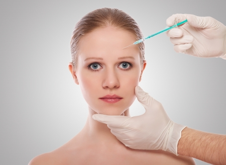 injection of Botox on forehead of female face  photo