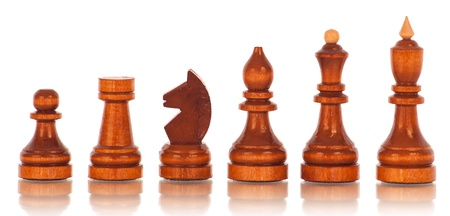 Chess. a group of black wooden chess pieces  Stock Photo