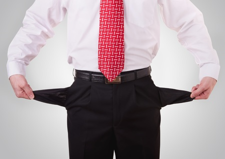 moneyless: business man showing his empty pockets