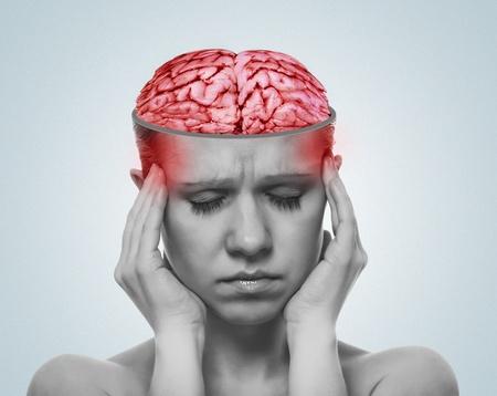 woman headache: concept of headache. open skull and inflamed brain