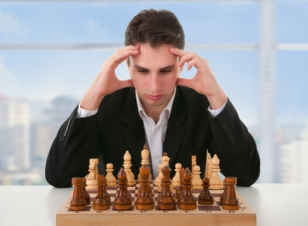 pawn adult: serious focused man thinks  on game of chess