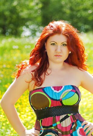 beautiful young red-haired redheaded woman outdoors on nature photo