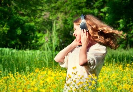flowing hair: girl in headphones enjoying music, flowing hair