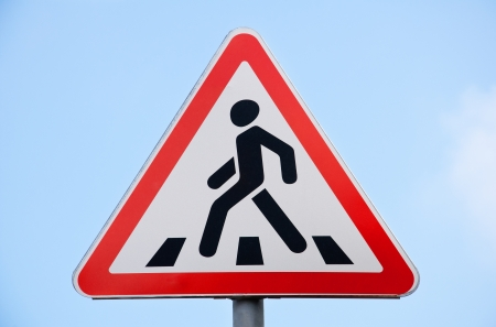 road sign pedestrian crossing against the blue sky photo