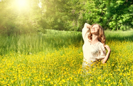 beautiful girl enjoying the summer sun outdoors photo