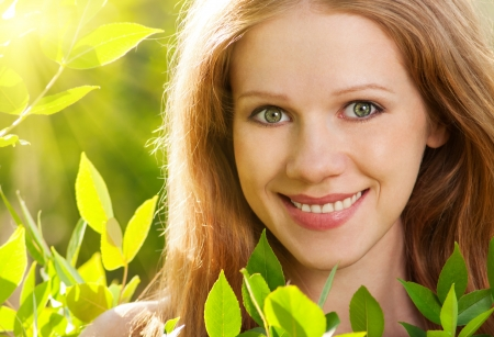 beauty girl in nature with green leaves photo